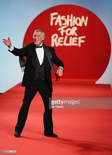 TV presenter Bruce Forsyth walks the runway at Fashion For Relief at Forville market during the 64th Annual Cannes Film Festival on May 16 2011 in...