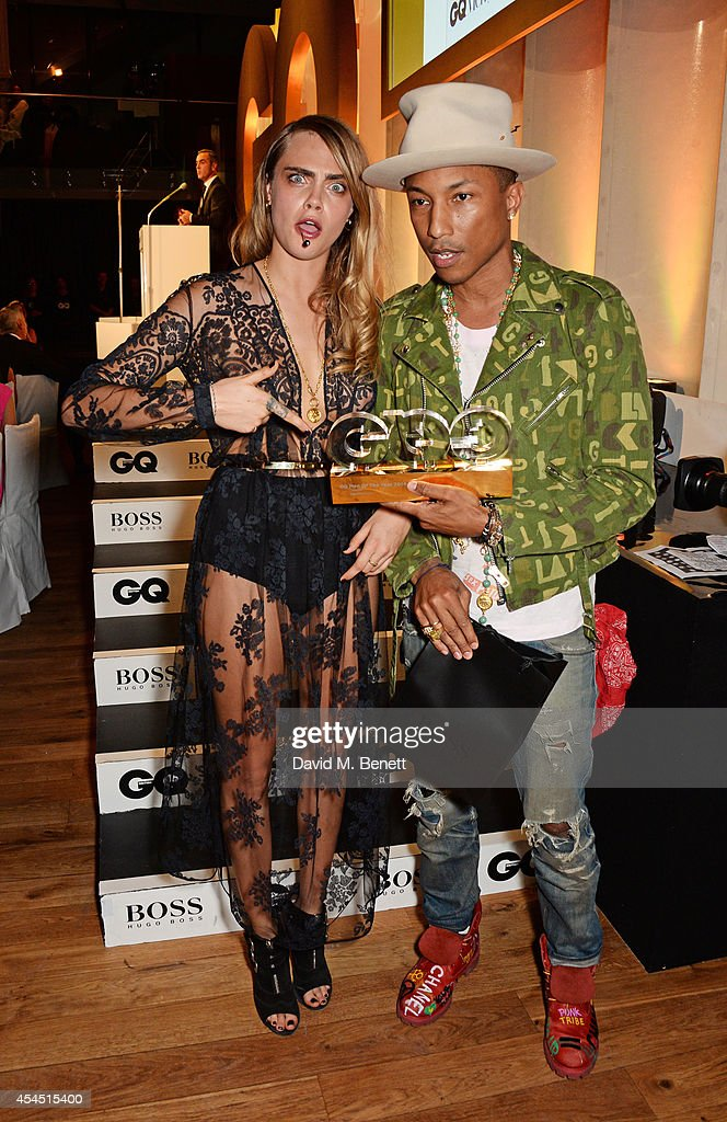 Presenter <a gi-track='captionPersonalityLinkClicked' href=/galleries/search?phrase=Cara+Delevingne&family=editorial&specificpeople=5488432 ng-click='$event.stopPropagation()'>Cara Delevingne</a> (L) and <a gi-track='captionPersonalityLinkClicked' href=/galleries/search?phrase=Pharrell+Williams&family=editorial&specificpeople=161396 ng-click='$event.stopPropagation()'>Pharrell Williams</a>, winner of the Solo Artist award, attend the GQ Men Of The Year awards in association with Hugo Boss at The Royal Opera House on September 2, 2014 in London, England.