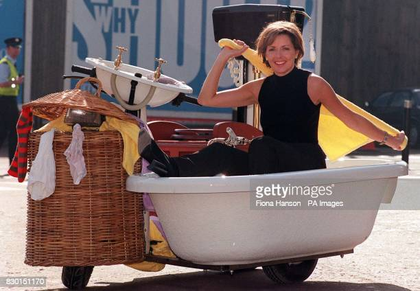 TV presenter Carol Vorderman arrives in style in a motorised bathroom at the Ideal Home Show in Earls Court London Since beginning in 1908 the show...