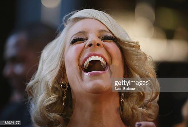 Presenter Carrie Bickmore laughs as she arrives at the 2013 Logie Awards at the Crown on April 7 2013 in Melbourne Australia