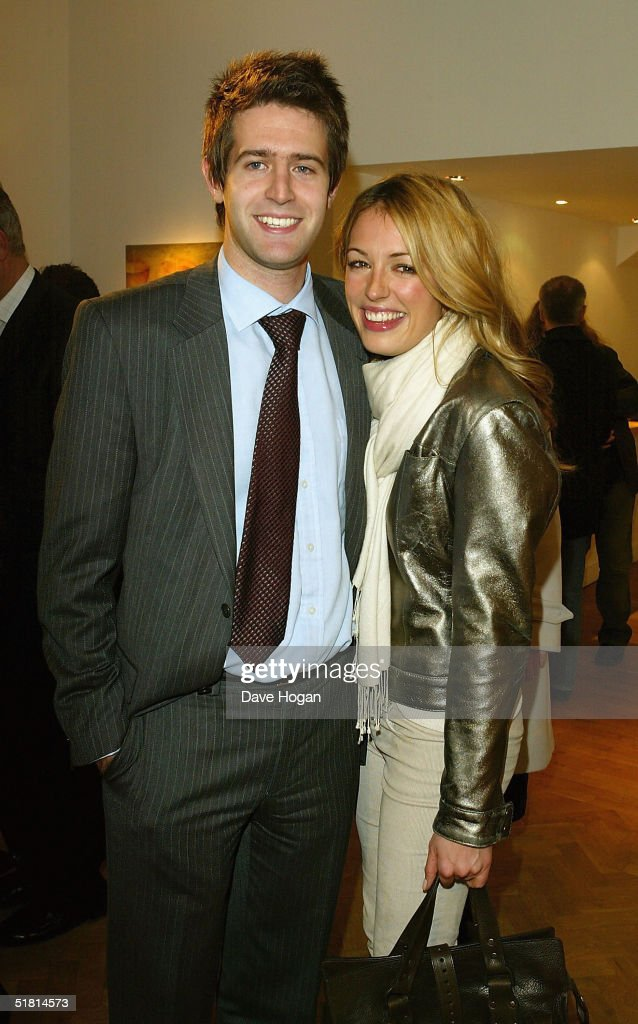 TV presenter Cat Deeley and her brother attend the opening of the new collection by the artist Guggi at the Osbourne Samuel Gallery on December 1, 2004 in London.