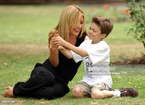 TV presenter Cat Deeley and Louis Burrows from London pose for photographers during a photocall to announce Deeley's new role as the first appointed...