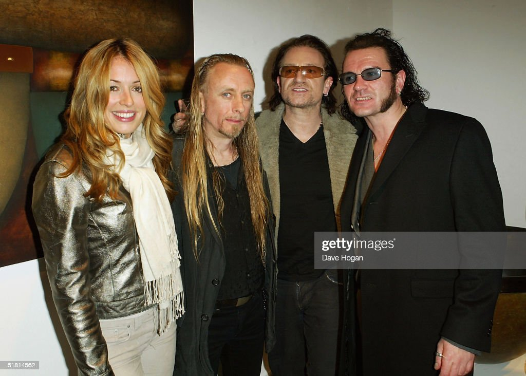 TV presenter Cat Deeley, artist Guggi, Bono and Gavin Friday attend the opening of the new collection by the artist at the Osbourne Samuel Gallery on December 1, 2004 in London.