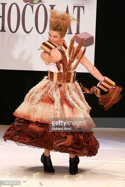 TV presenter Cecile Belin dressed by Barry Callebaut and Sally Rudock walks the runway at the Salon Du Chocolat 2010 Opening Night at the Parc des...