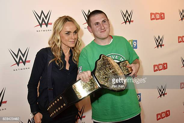 TV presenter Cecile de Menibus and a fan attend 'WLIVE REVENGE' Wrestlemania Show Party at Hotel Accor Arena Bercy on April 22 2016 in Paris France