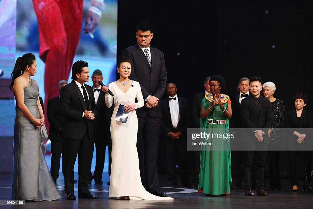 Presenter Chen Chen speaks with new Laureus Academy member <a gi-track='captionPersonalityLinkClicked' href=/galleries/search?phrase=Sachin+Tendulkar&family=editorial&specificpeople=201846 ng-click='$event.stopPropagation()'>Sachin Tendulkar</a> with former Basketball player <a gi-track='captionPersonalityLinkClicked' href=/galleries/search?phrase=Yao+Ming&family=editorial&specificpeople=201476 ng-click='$event.stopPropagation()'>Yao Ming</a> of China and Laureus World Sports Academy member Yang Yang (C) onstage during the 2015 Laureus World Sports Awards show at the Shanghai Grand Theatre on April 15, 2015 in Shanghai, China.