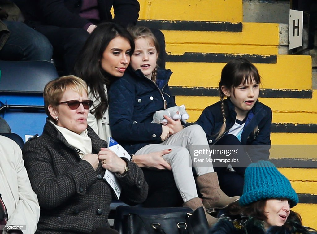 TV presenter Christine Bleakley sits with Frank Lampard's daughters Isla and Luna during the Barclays Premier League match between Chelsea and Sunderland at Stamford Bridge on April 7, 2013 in London, England.