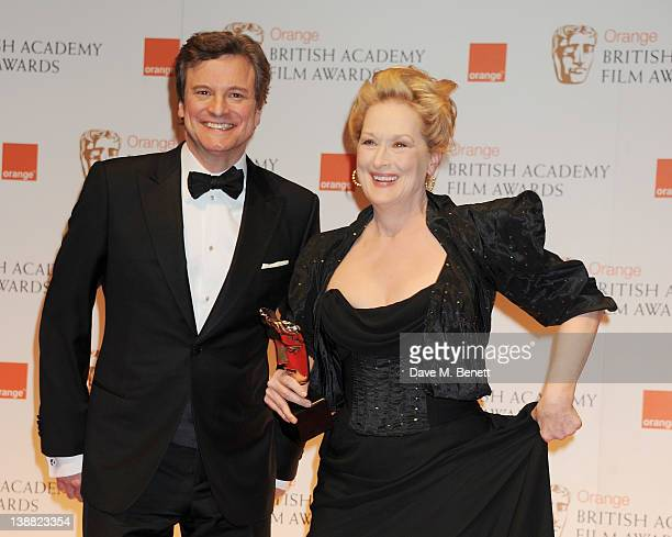 Presenter Colin Firth and Best Actress winner Meryl Streep pose in the press room at the Orange British Academy Film Awards 2012 at The Royal Opera...