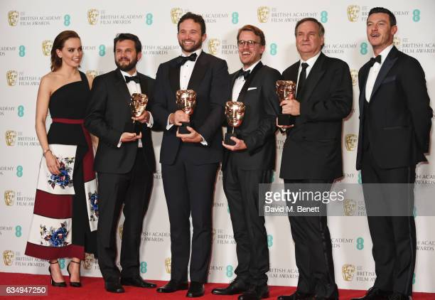 Presenter Daisy Ridley Robert Legato Dan Lemmon Andrew R Jones and Adam Valdez winners of the Special Visual Effects award for 'The Jungle Book' and...