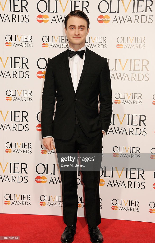 Presenter Daniel Radcliffe poses in the press room at The Laurence Olivier Awards 2013 at The Royal Opera House on April 28, 2013 in London, England.