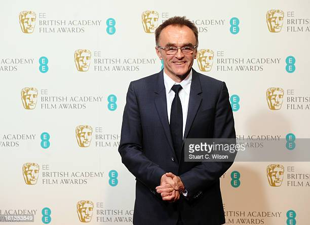 Presenter Danny Boyle poses in the press room at the EE British Academy Film Awards at The Royal Opera House on February 10 2013 in London England
