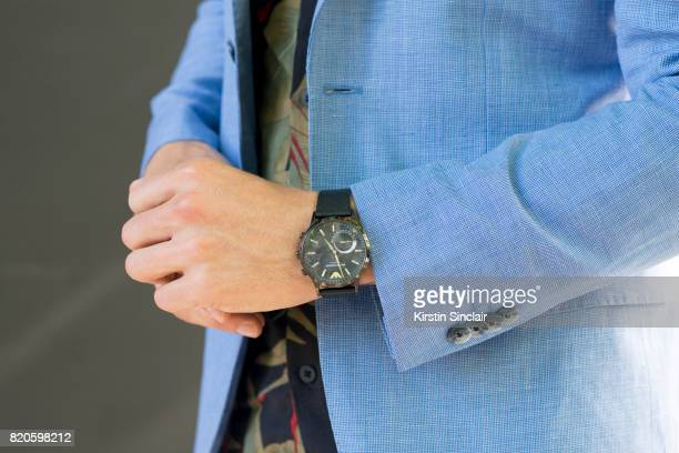 Presenter Darren Kennedy wears H and M suit and shirt Armani watch on day 3 of London Collections Men on June 11 2017 in Paris France