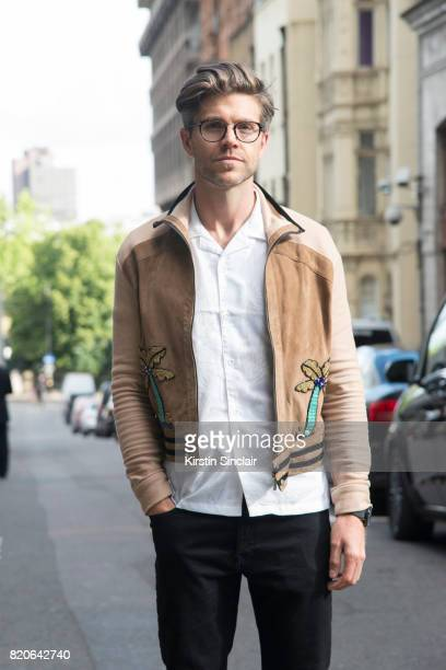 TV presenter Darren Kennedy wears Specsavers glasses and Top Man shirt jacket and trousers on day 1 of London Collections Men on June 9 2017 in Paris...