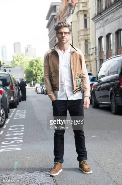 TV presenter Darren Kennedy wears Specsavers glasses Kurt Geiger shoes and Top Man shirt jacket and trousers on day 1 of London Collections Men on...
