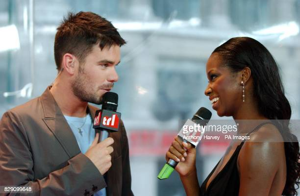 MTV presenter Dave Berry with singer Jamelia during her guest appearance on MTV's TRL Total Request Live show at their new studios in Leicester...