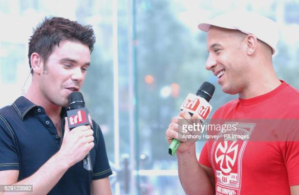 MTV presenter Dave Berry with US actor Vin Diesel during his guest appearance on MTV's TRL Total Request Live show at their new studios in Leicester...