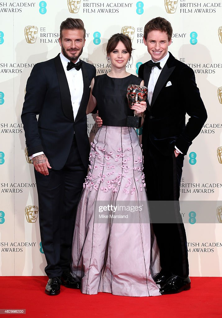 Presenter David Beckham (L) poses with Felicity Jones (C) and Eddie Redmayne with the Outstanding British Film award for 'The Theory Of Everything' in the winners room at the EE British Academy Film Awards at The Royal Opera House on February 8, 2015 in London, England.