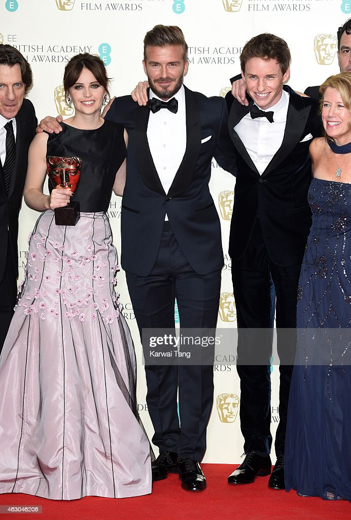Presenter David Beckham (C) poses with Felicity Jones (L) and Eddie Redmayne with the Outstanding British Film award for 'The Theory Of Everything' in the winners room at the EE British Academy Film Awards at The Royal Opera House on February 8, 2015 in London, England.