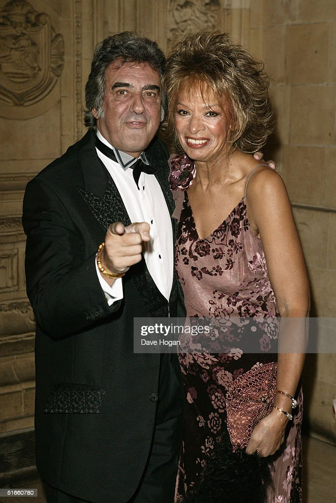 Presenter David Dickinson (L) and his wife Lorne Leslie arrive at the '10th Anniversary National Television Awards' at the Royal Albert Hall on October 26, 2004 in London. The star-studded awards ceremony awards prizes as voted for by members of the public.
