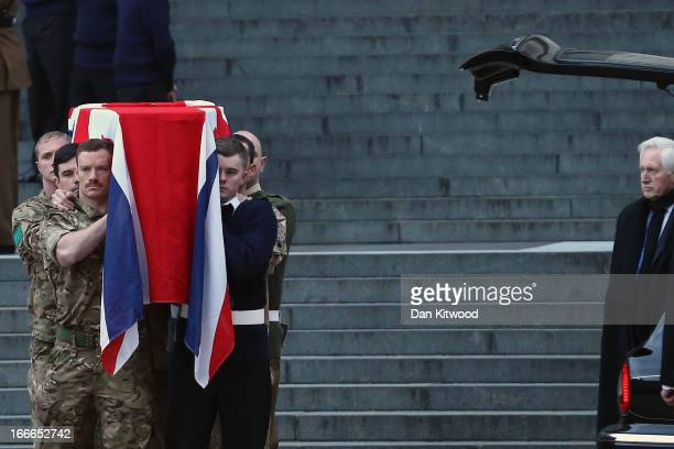 TV presenter David Dimbleby looks on as a flag draped coffin is carried out during a full military rehearsal for the ceremonial funeral procession...