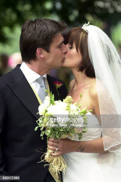 TV presenter Davina McCall and Matthew Robertson kiss after their marriage ceremony at the St John the Baptist church Eastnor near Ledbury Ms McCall...