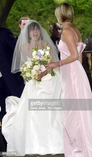 TV presenter Davina McCall jokes with bridesmaid Jane Wood before her marriage to fellow TV presenter Matthew Robertson at the St John the Baptist...