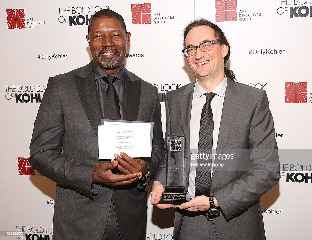 Presenter <a gi-track='captionPersonalityLinkClicked' href=/galleries/search?phrase=Dennis+Haysbert&family=editorial&specificpeople=212993 ng-click='$event.stopPropagation()'>Dennis Haysbert</a> and Production Designer Todd Cherniawsky receives the award for Excellence in Production Design for a Commercial or Music Video 2013 - Call of Duty: Ghosts 'Epic Night Out' at the 18th Annual ADG Awards held at The Beverly Hilton Hotel on February 8, 2014 in Beverly Hills, California.
