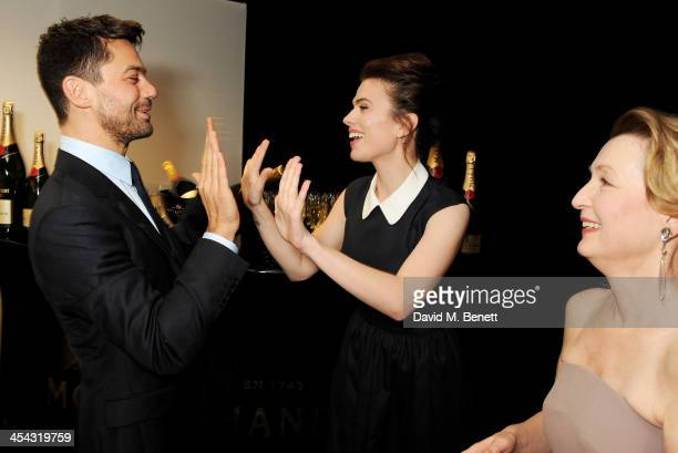 Presenter Dominic Cooper Hayley Atwell and Lesley Manville attend the Moet British Independent Film Awards 2013 at Old Billingsgate Market on...