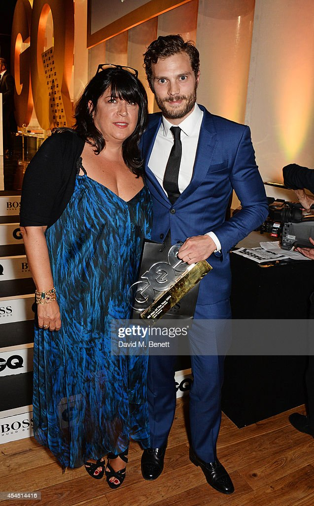 Presenter E.L. James (L) and <a gi-track='captionPersonalityLinkClicked' href=/galleries/search?phrase=Jamie+Dornan&family=editorial&specificpeople=243194 ng-click='$event.stopPropagation()'>Jamie Dornan</a>, winner of the Vertu Breakthrough award, attend the GQ Men Of The Year awards in association with Hugo Boss at The Royal Opera House on September 2, 2014 in London, England.