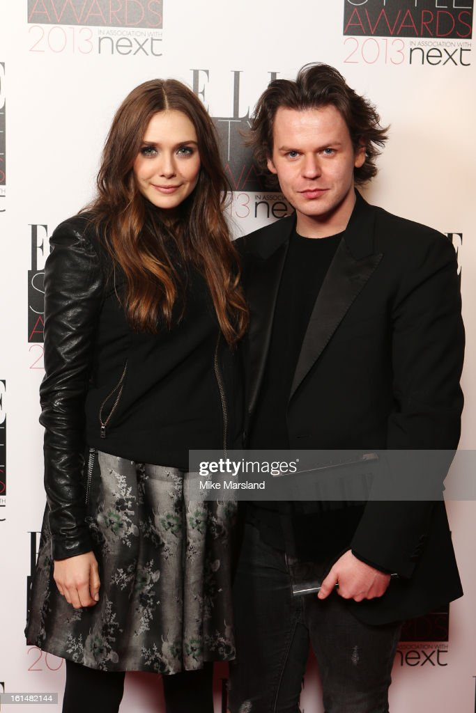 Presenter Elizabeth Olsen and Best Britsh Designer of the Year winner Christopher Kane pose in the press room at the Elle Style Awards at The Savoy Hotel on February 11, 2013 in London, England.