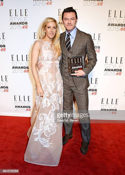Presenter Ellie Goulding and Luke Evans winner of the Actor of the Year award pose in the Winners Room at the Elle Style Awards 2015 at Sky Garden @...