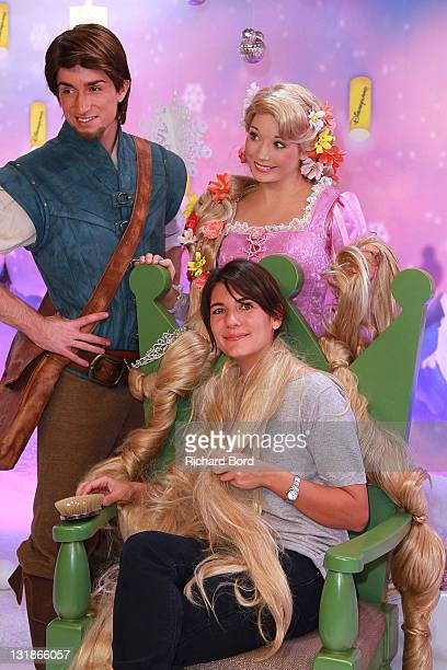 TV presenter Estelle Denis poses with Raiponce and Flynn as they attend the Raiponce Premiere during the Christmas Season Launch at Disneyland Paris...