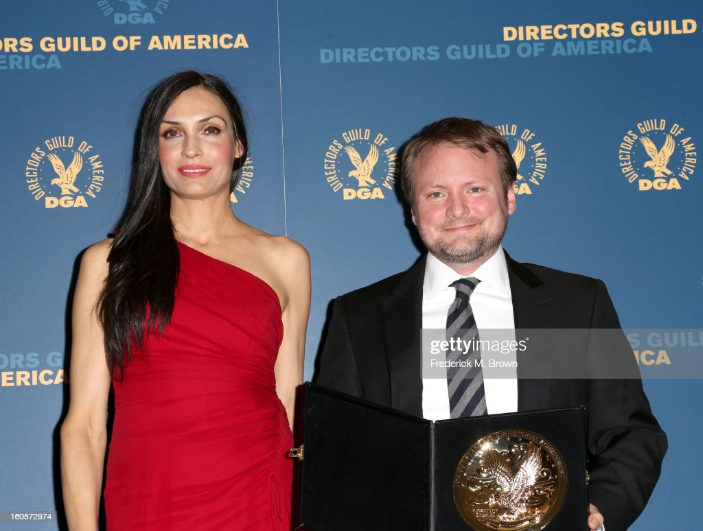 Presenter <a gi-track='captionPersonalityLinkClicked' href=/galleries/search?phrase=Famke+Janssen&family=editorial&specificpeople=202594 ng-click='$event.stopPropagation()'>Famke Janssen</a> (L) and director Rian Johnson, winner of the Outstanding Directorial Achievement in Dramatic Series for the 'Breaking Bad' episode 'Fifty-One,' pose in the press room during the 65th Annual Directors Guild Of America Awards at Ray Dolby Ballroom at Hollywood & Highland on February 2, 2013 in Los Angeles, California.