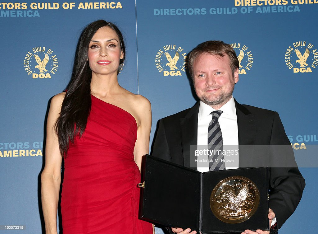 Presenter Famke Janssen (L) and director Rian Johnson, winner of the Outstanding Directorial Achievement in Dramatic Series for the 'Breaking Bad' episode 'Fifty-One,' pose in the press room during the 65th Annual Directors Guild Of America Awards at Ray Dolby Ballroom at Hollywood & Highland on February 2, 2013 in Los Angeles, California.