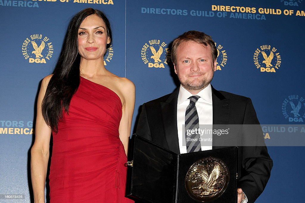 Presenter Famke Janssen (L) and director Rian Johnson, winner of the Outstanding Directorial Achievement in Dramatic Series, pose in the press room at the 65th Annual Directors Guild Of America Awards at The Ray Dolby Ballroom at Hollywood & Highland Center on February 2, 2013 in Hollywood, California.