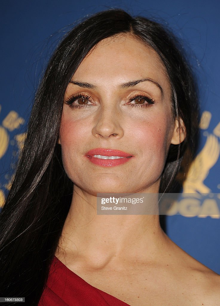 Presenter Famke Janssen poses in the press room at the 65th Annual Directors Guild Of America Awards at The Ray Dolby Ballroom at Hollywood & Highland Center on February 2, 2013 in Hollywood, California.