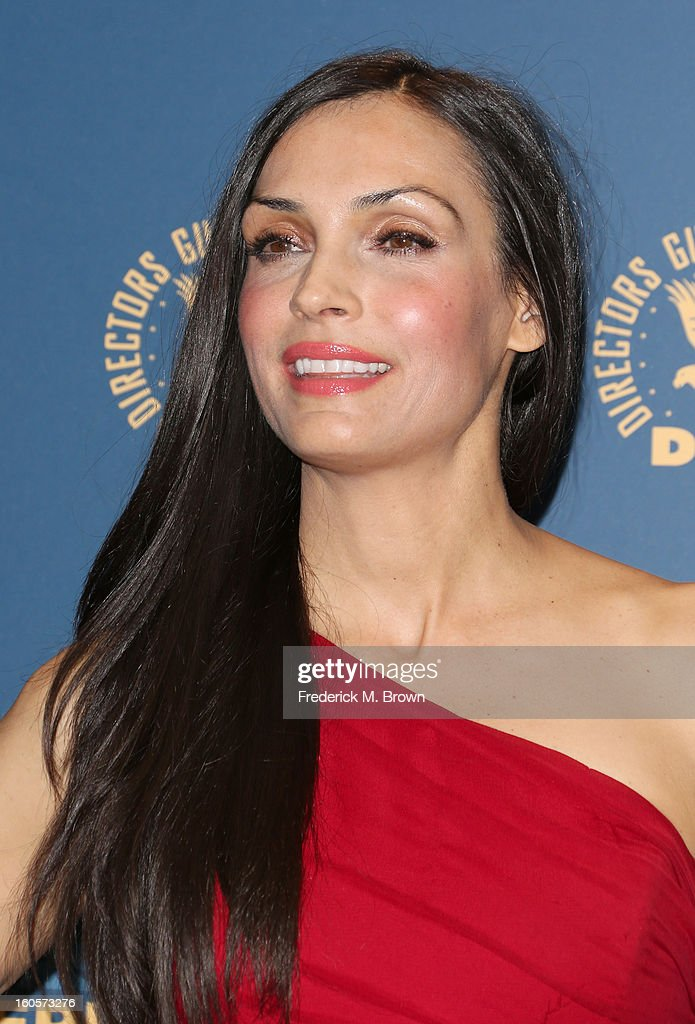 Presenter Famke Janssen poses in the press room during the 65th Annual Directors Guild Of America Awards at Ray Dolby Ballroom at Hollywood & Highland on February 2, 2013 in Los Angeles, California.