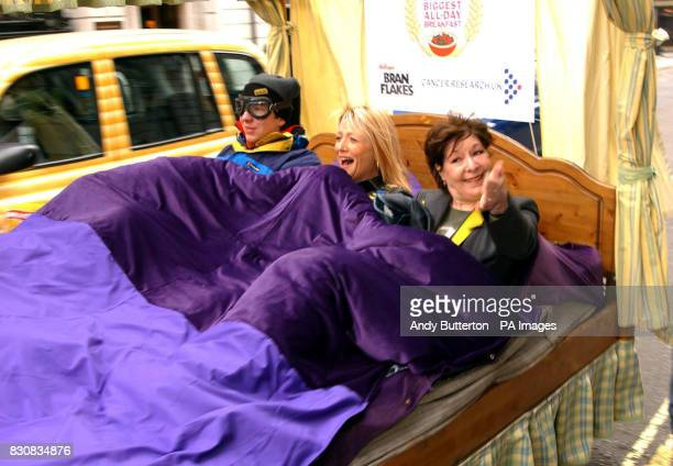 TV presenter Gaby Roslin and actress Roberta Taylor take to the road in a motorised bed during a photocall outside the Ritz Hotel central London to...