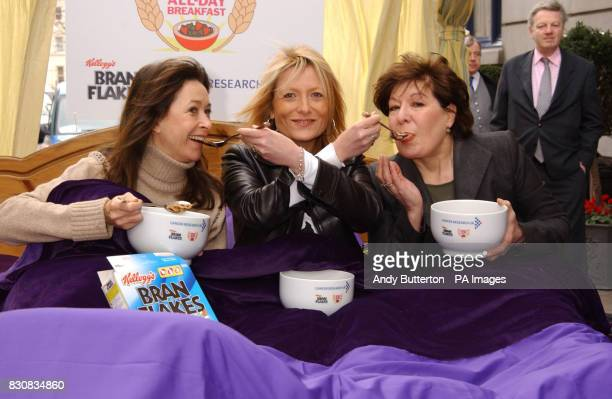 TV presenter Gaby Roslin flanked by actress Cherie Lunghi and Roberta Taylor during a photocall outside the Ritz Hotel central London to launch...