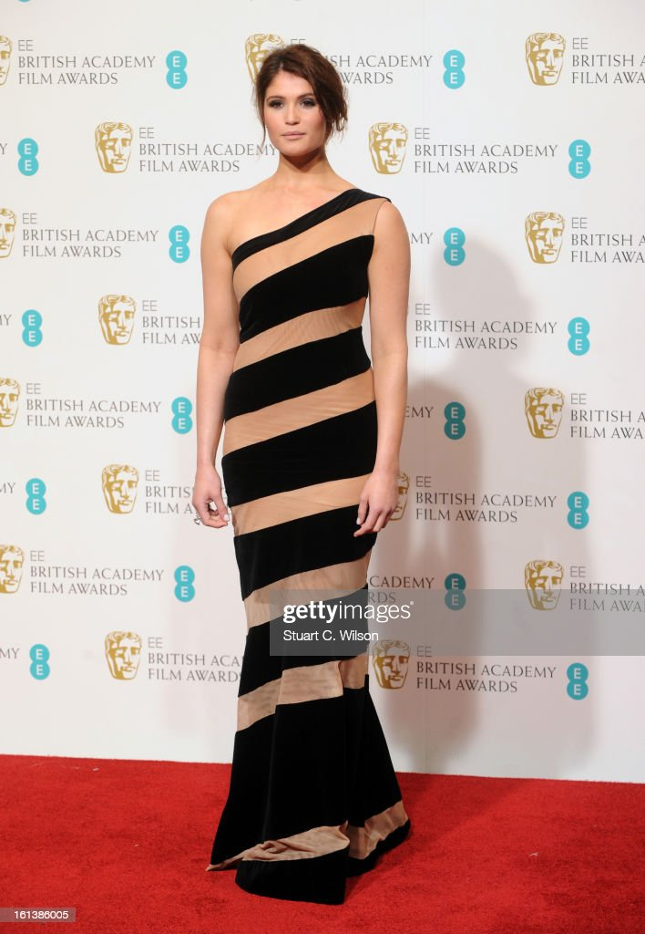 Presenter Gemma Arterton poses in the press room at the EE British Academy Film Awards at The Royal Opera House on February 10, 2013 in London, England.