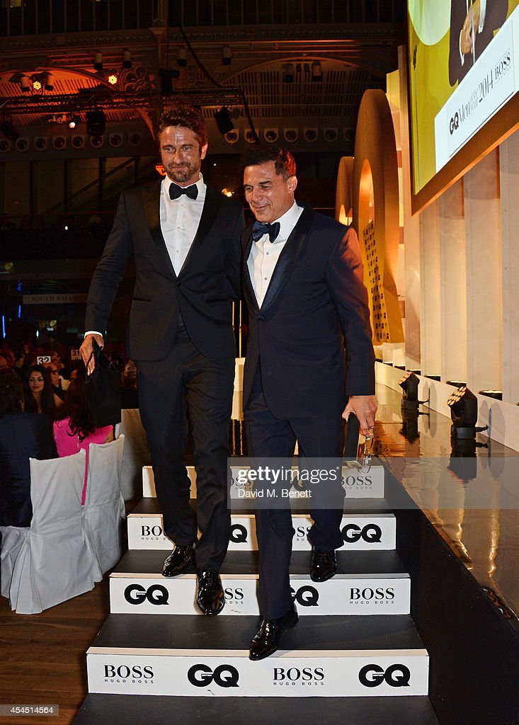 Presenter Gerard Butler (L) and Andre Balazs, winner of the Entrepreneur of the Year award, attend the GQ Men Of The Year awards in association with Hugo Boss at The Royal Opera House on September 2, 2014 in London, England.