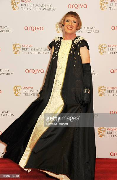 Presenter Grayson Perry poses in the press room at the Arqiva British Academy Television Awards 2013 at the Royal Festival Hall on May 12 2013 in...