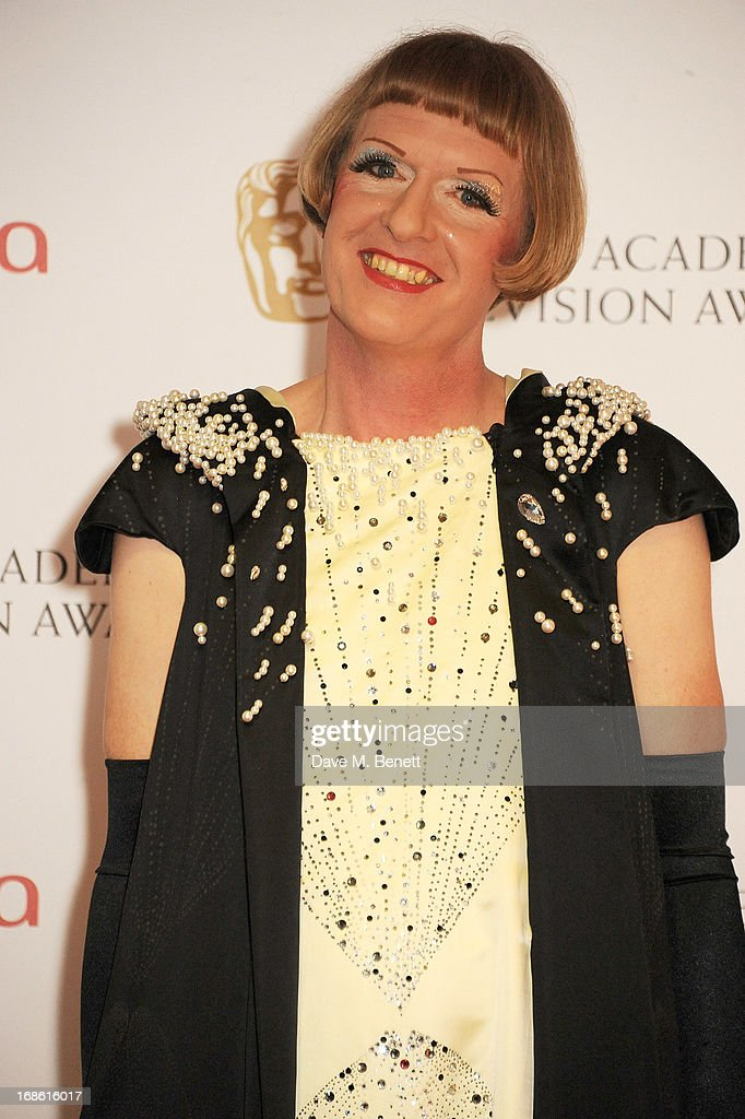 Presenter Grayson Perry poses in the press room at the Arqiva British Academy Television Awards 2013 at the Royal Festival Hall on May 12, 2013 in London, England.