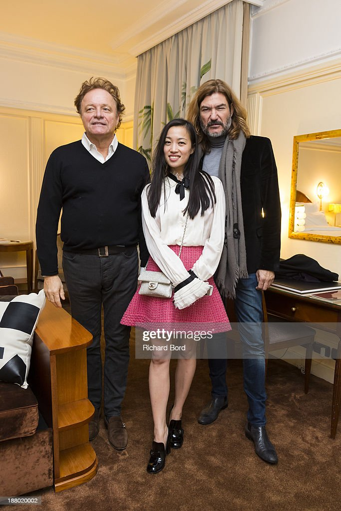 TV Presenter Guillaume Durand, artist Yi Zhou and Elly Habib pose in the Yi Zhou's 'Paradise Suite' at Hotel Lutetia on November 14, 2013 in Paris, France.