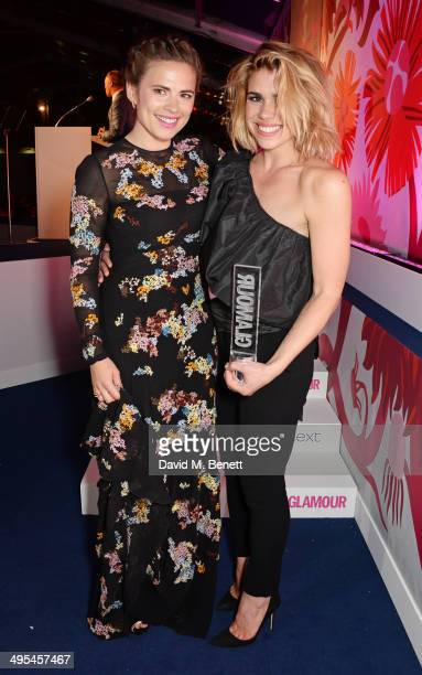 Presenter Hayley Atwell and Theatre Actress award winner Billie Piper pose at the Glamour Women of the Year Awards in Berkeley Square Gardens on June...