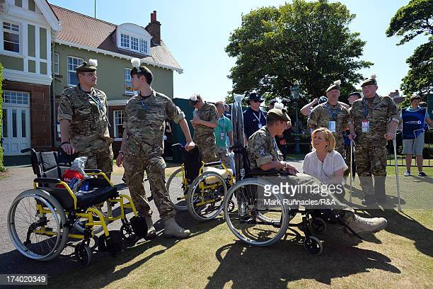 BBC presenter Hazel Irvine speaks to injured soldiers from the Royal Regiment of Scotland during the second round of the 142nd Open Championship at...