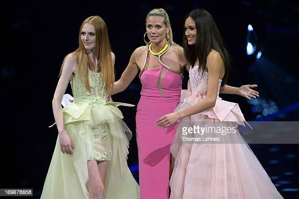 Presenter Heidi Klum Lovelyn Enebechi and Maike van Grieken react during the final of 'Germany's Next Top Model by Heidi Klum ' TV show at SAP Arena...
