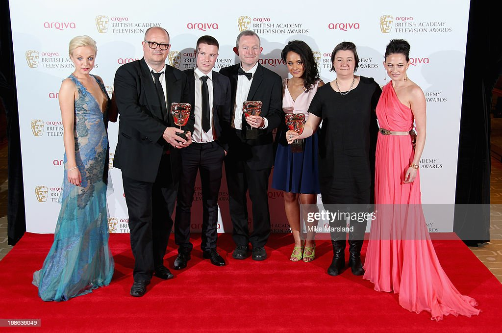 Presenter Helen George and the winners of the Best Single Drama award Birger Larson, Joe Dempsey, Robert Jones, Carla Chrome and Kath Mattock with presenter Lara Pulver during the Arqiva British Academy Television Awards 2013 at the Royal Festival Hall on May 12, 2013 in London, England.