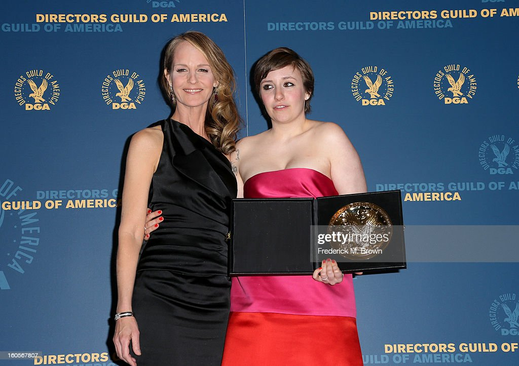 Presenter Helen Hunt (L) and actress/director Lena Dunham, winner of the Outstanding Directorial Achievement in Comedy Series for the 'Girls' pilot episode, pose in the press room during the 65th Annual Directors Guild Of America Awards at Ray Dolby Ballroom at Hollywood & Highland on February 2, 2013 in Los Angeles, California.
