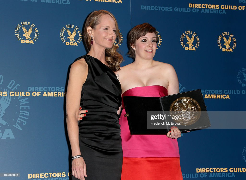Presenter Helen Hunt (L) and actress/director Lena Dunham, winner of the Outstanding Directorial Achievement in Comedy Series for the 'Girls' pilot episode, poses in the press room during the 65th Annual Directors Guild Of America Awards at Ray Dolby Ballroom at Hollywood & Highland on February 2, 2013 in Los Angeles, California.